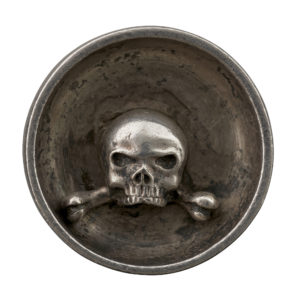 Deep relief on the reverse of this cast medal attributed to Drentwett, which features a vanitas theme.